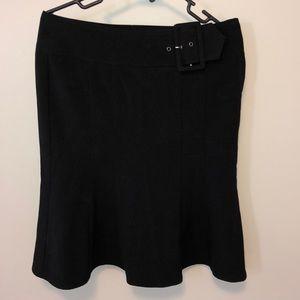Black skirt with buckle just below the knees